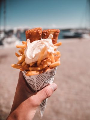 close-up-photography-of-french-fries-with-cream-2034899